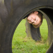 Little boy playing hide-and-seek inside a contraption made of ol — Stock Photo #7117382