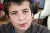 Young boy trying not to smile — Stock Photo