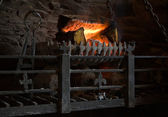 Old fashioned lit fireplace with wood fire — Stock Photo