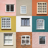 Collection of old window on different colored walls — Stockfoto