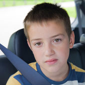 Boring car journey - cute little boy in a back seat of a car — Stock Photo