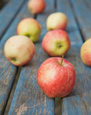 Red apples on old garden table, — Stock Photo