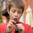 Young boy playing a recorder outside — Stock Photo #7722071
