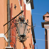 Old corner street lamp on Burano, Italy; Veneto — Stock Photo