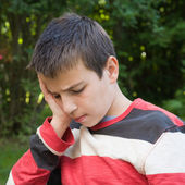 Thoughtful pre-teen boy outdoors — Stock Photo