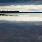 View over clam northern lake, summer late evening — Stock Photo
