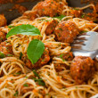 Original Italian spaghetti with meatballs in tomato sauce - Stock Photo