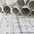 Stock Photo: Architect rolls and plans