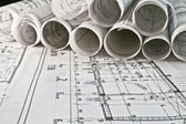 Rollos de arquitecto y planes — Foto de Stock