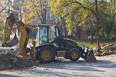 Excavator on site working — Stock Photo