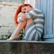 Sad young woman on the stairs — Stock Photo