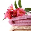 Spa towels with some alstroemeria flowers — Stock Photo