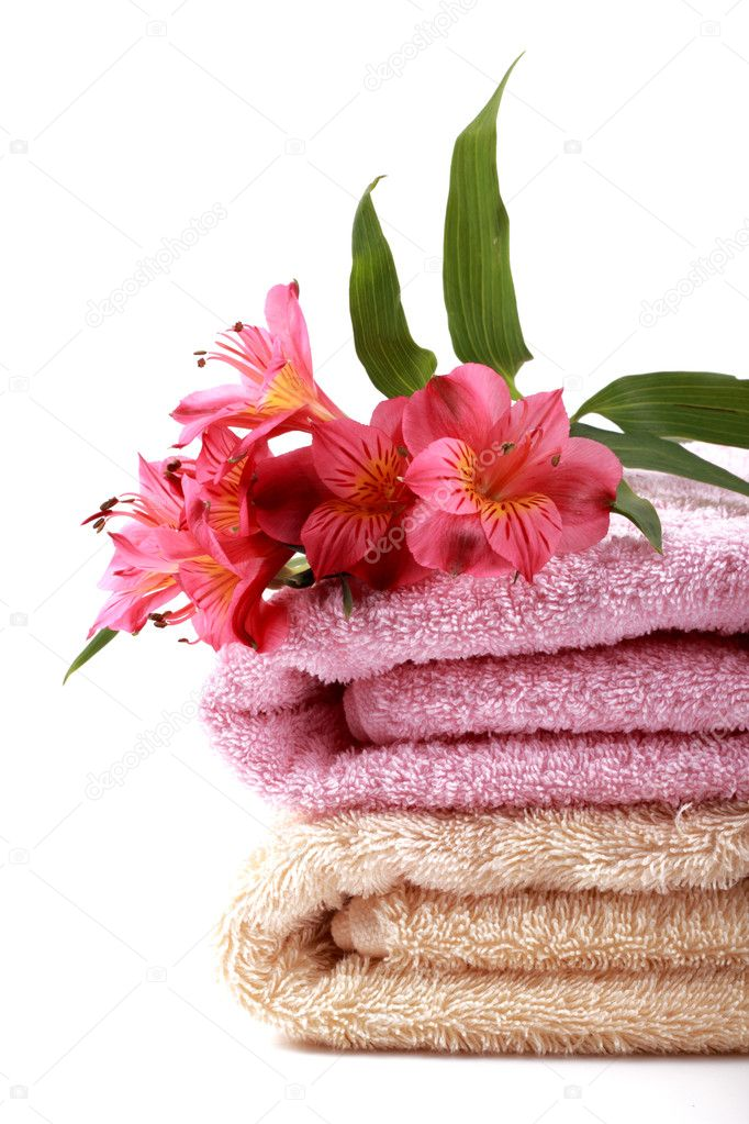 Stack of spa soft towels with coral flowers on a white background — Stock Photo #6944517