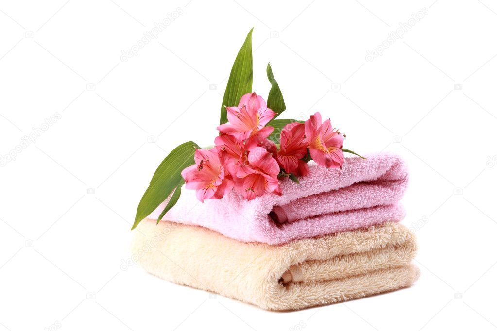Stack of spa soft towels with coral flowers on a white background — Stock Photo #6944519