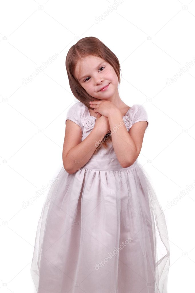 Happy smiling little girl on white background in studio  Stock Photo #6966780