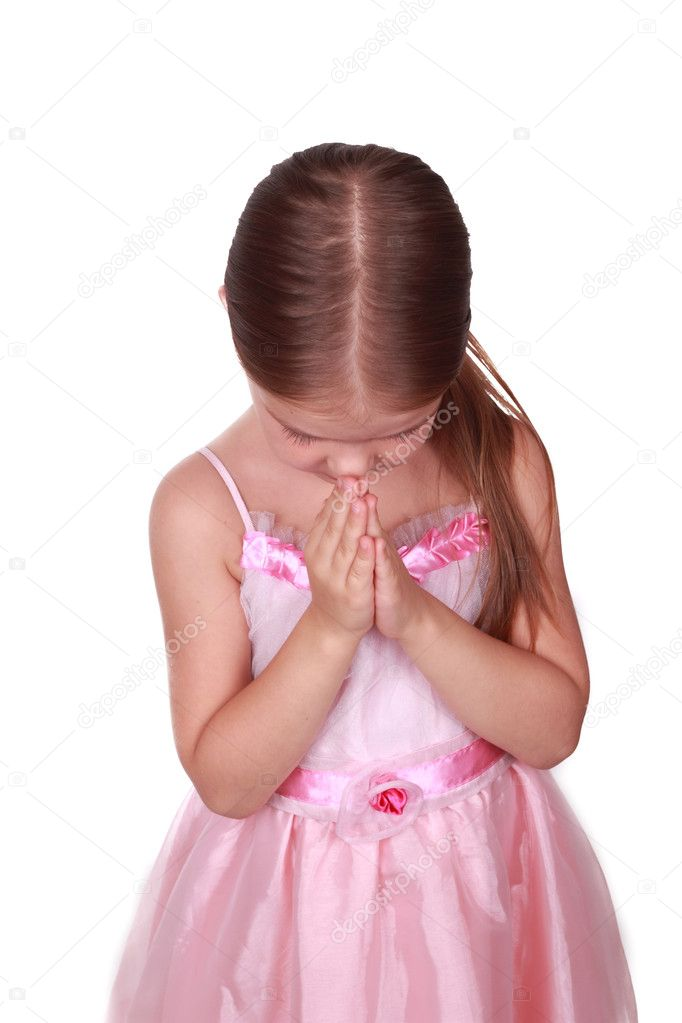 Portrait of an adorable praying girl over white background — Stock Photo #7035304