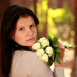 Adorable woman with roses — Stock Photo #7104282