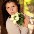 Young beautiful woman with roses — Stock Photo #7104283