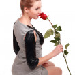 Lovely girl holds red rose — Stock Photo #7467747