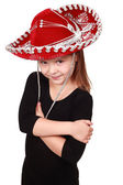 Lovely little girl in a red cowboy hat — Stock Photo