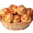 Small puff pastries in a basket — Stock Photo