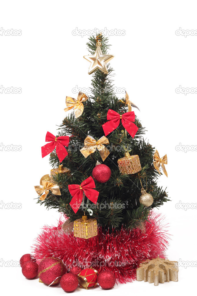 Photo shoot of mini decorative Christmas tree with heap of red decorative balls over white background — Stock Photo #7581166