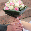 Stock Photo: Hands of bride and groom with rings