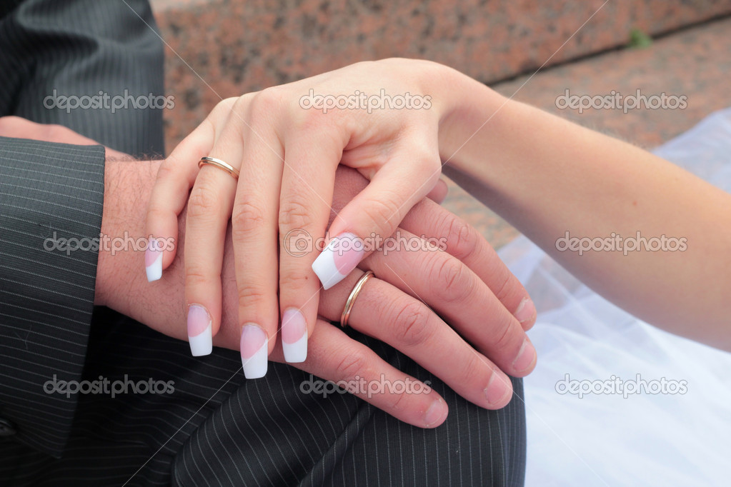 Couple holding hands with wedding rings (just married) — Stock Photo #7713727