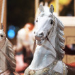 Carousel horse ride at a amusemnent park - Stock Photo
