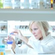 Closeup of a female researcher working in a lab — Stock Photo