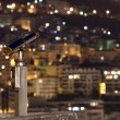 Night city (with a telescope in the foreground, focus is on the — Stock Photo