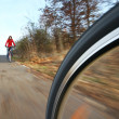 Biking (the image is motion blurred to convey movement; focus i — Stock Photo #7415923