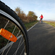 Photo: Biking (the image is motion blurred to convey movement; focus is