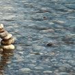 Royalty-Free Stock Photo: Pebble pyramid in a river
