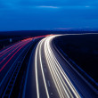 Cars moving fast on a highway — Stock Photo #7416130