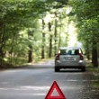 Broken down car with warning triangle behind it waiting for assi — Stock Photo