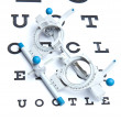 Optometry concept - sight measuring spectacles & eye chart — 图库照片 #7416204
