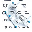 Optometry concept - sight measuring spectacles & eye chart — Photo