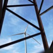 Wind energy concept - wind energy harvesting wind mill seen thro — Stock Photo
