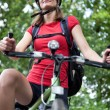 Pretty young female biker outddors on her mountain bike (shallow — Stock Photo #7416576
