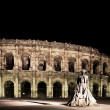 Statue of famous bullfighter in front of the arena in Nimes, France. - Stock Photo