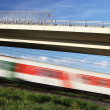 Fast train passing under a bridge on a lovely summer day — Stock Photo #7416987