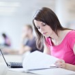 In the library - pretty female student with laptop and books — Stock Photo #7417379