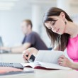 In the library - pretty female student with laptop and books wor — Stock Photo #7417457