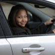Young woman driving her new car. — Stock Photo