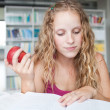 Pretty female college student in a library (shallow DOF; color t — Stock Photo #7417550