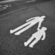 Parental guidance concept - pedestrian sign on the pavement/sid — Stock Photo