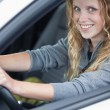 Pretty young woman driving her new car — Stock Photo #7417767