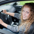 Pretty young woman driving her new car — Stock Photo #7417783