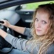 Pretty young woman driving her new car — Stock Photo #7417788
